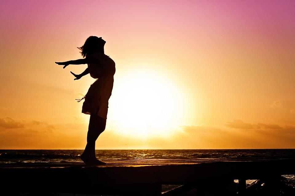 Women Standing Against Sunset